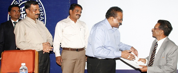 Mr.Rizwan Sheriff, Controller-Plantation and Allied Operations-Woodbriar, receiving the 'TGLIA - STC' Golden Tea Leaf Award for the best CTC - Fannings & Dust awarded to Sussex Estate from Mr. M.G.V.K. Bhanu, Chairman, Tea Board, at the launching of UCEL E-auction